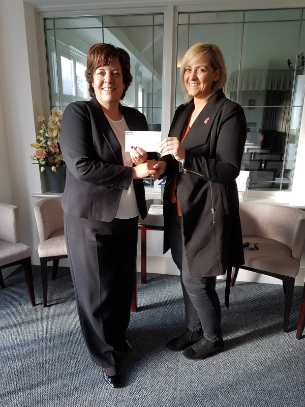 Manager Nan Evans presenting the cheque to Debbie Rowley of Tenovus Cancer Care